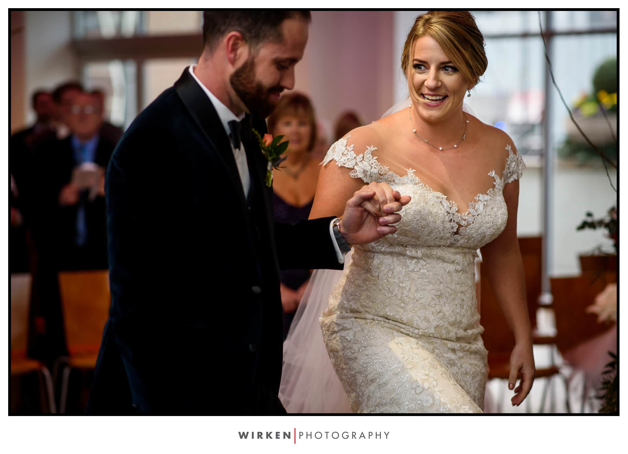 Leah walks to the alter at their ceremony at The Gallery Event Center