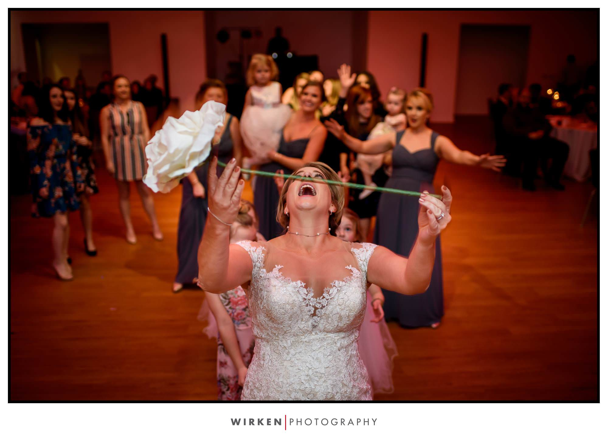 Leah tosses a flower at her her Gallery Event Space wedding reception.
