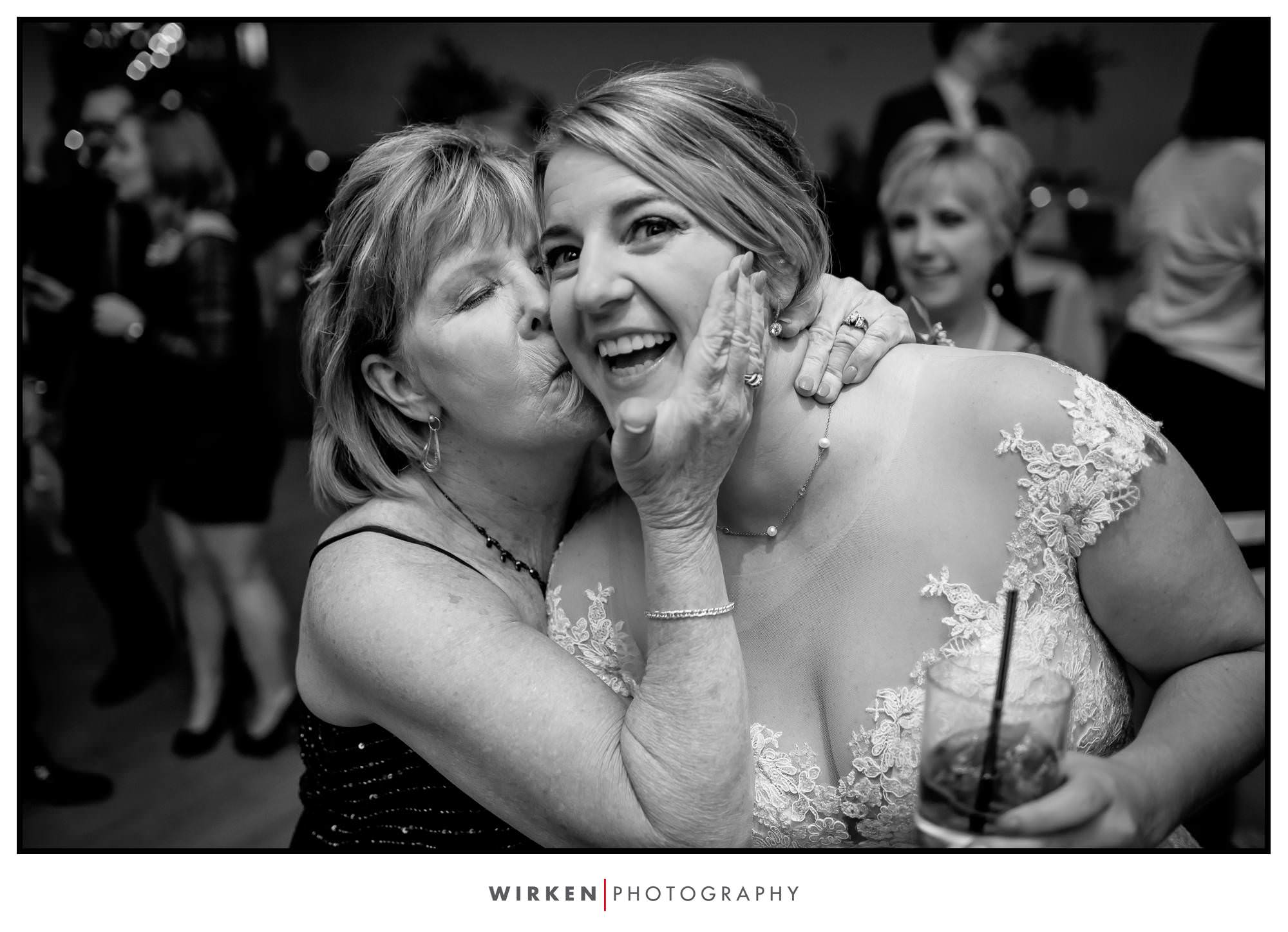 Leah gets a smooch from her mom at her wedding reception.