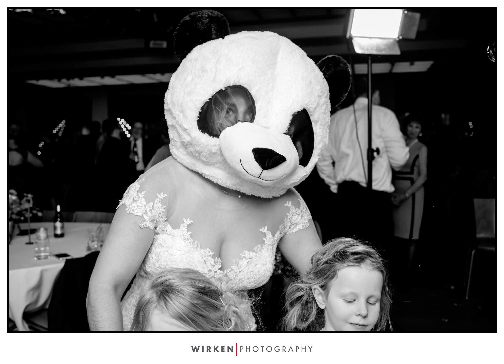Leah wears a Panda mask at her Gallery event Center wedding reception
