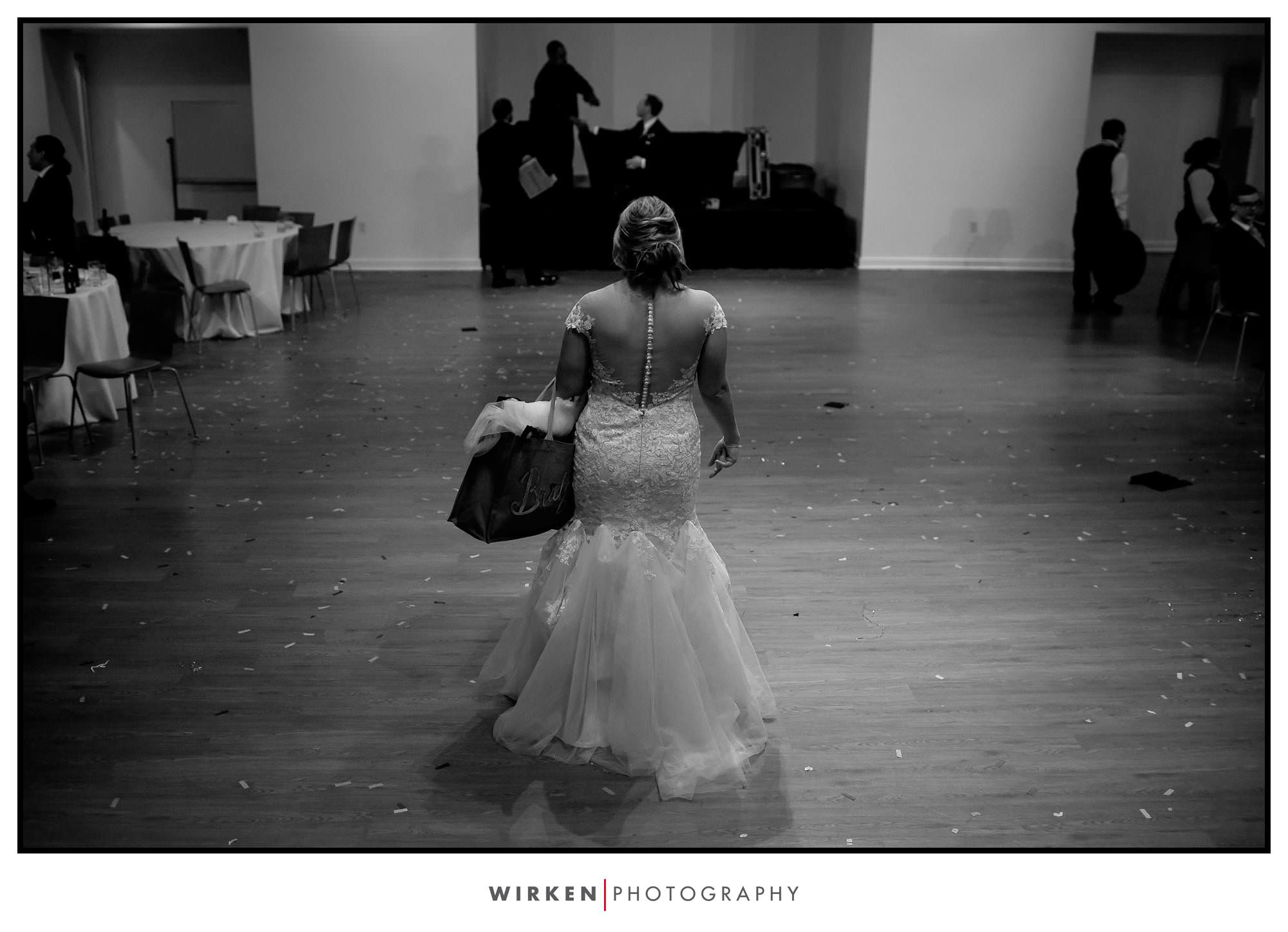 Leah exits from her wedding reception at the Gallery Event Center.