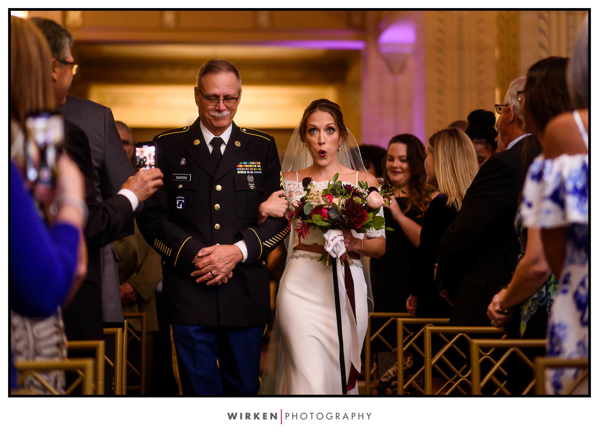 Bride and father walk down the aisle at the Grand Hall in Kansas City