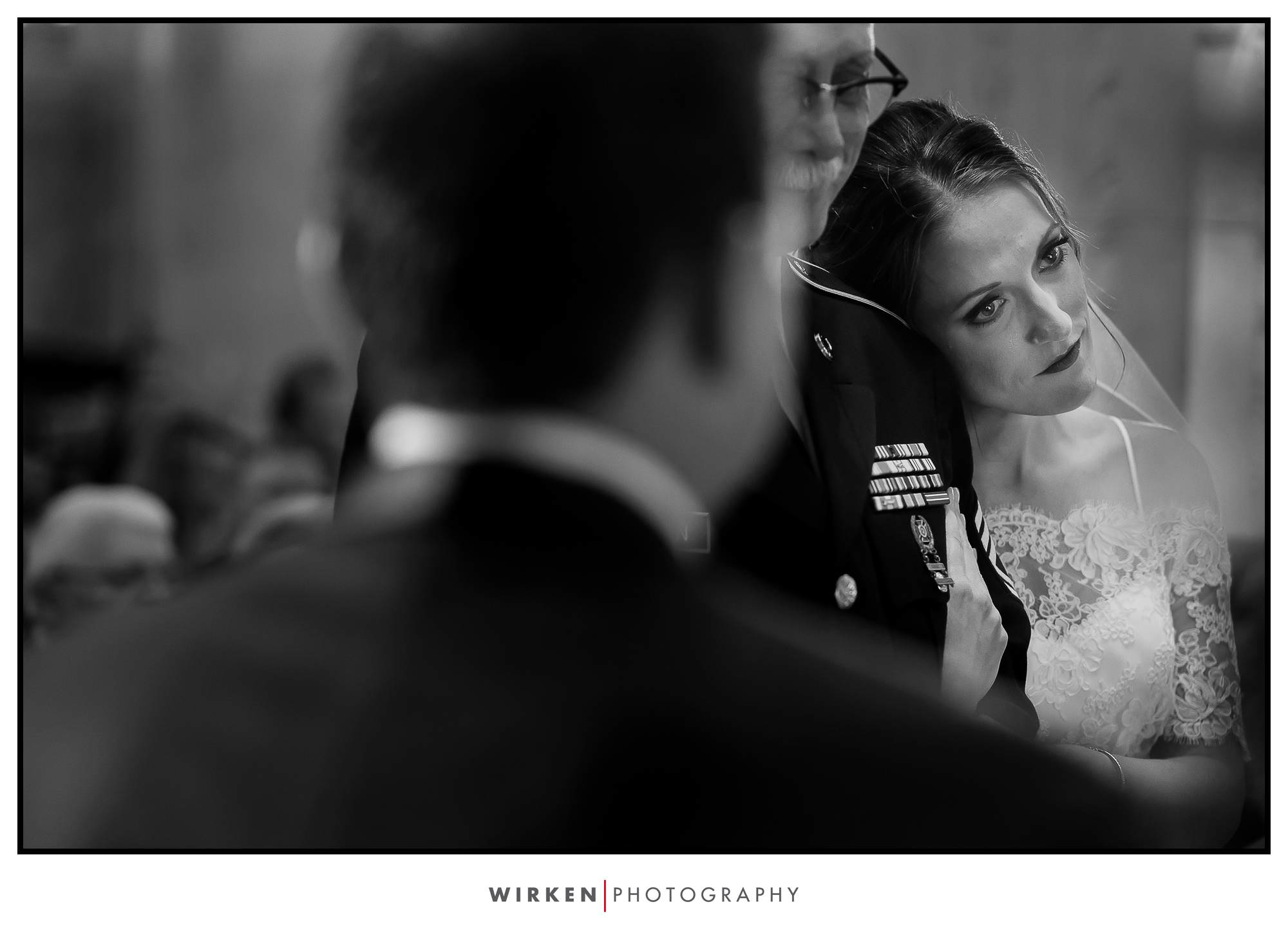 Bride holds her father before he hands her off at their Grand Hall wedding in Kansas City