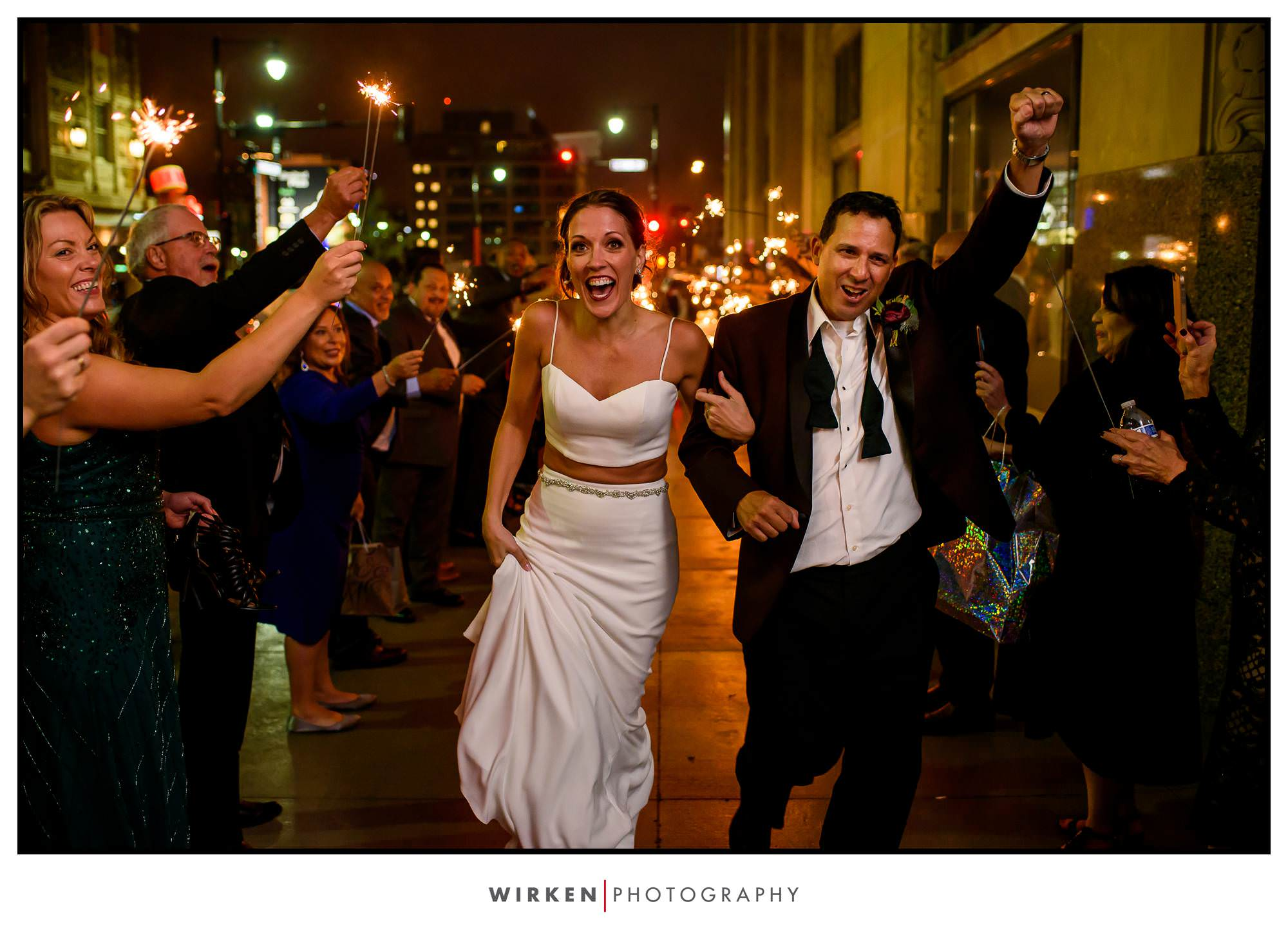 Bride and groom exit with sparklers after their Grand Hall wedding reception in Kansas City.