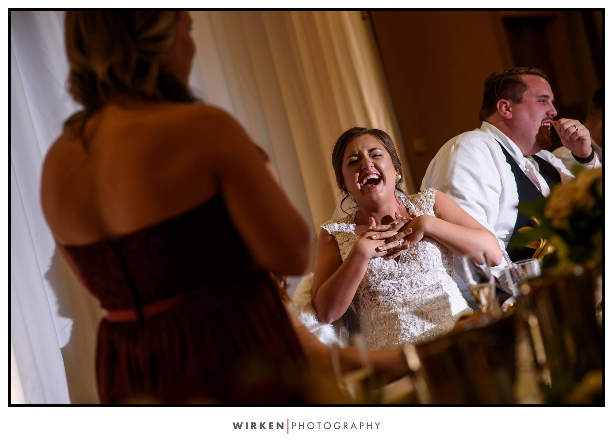 bride laughing at bridal toast at kansas city wedding reception