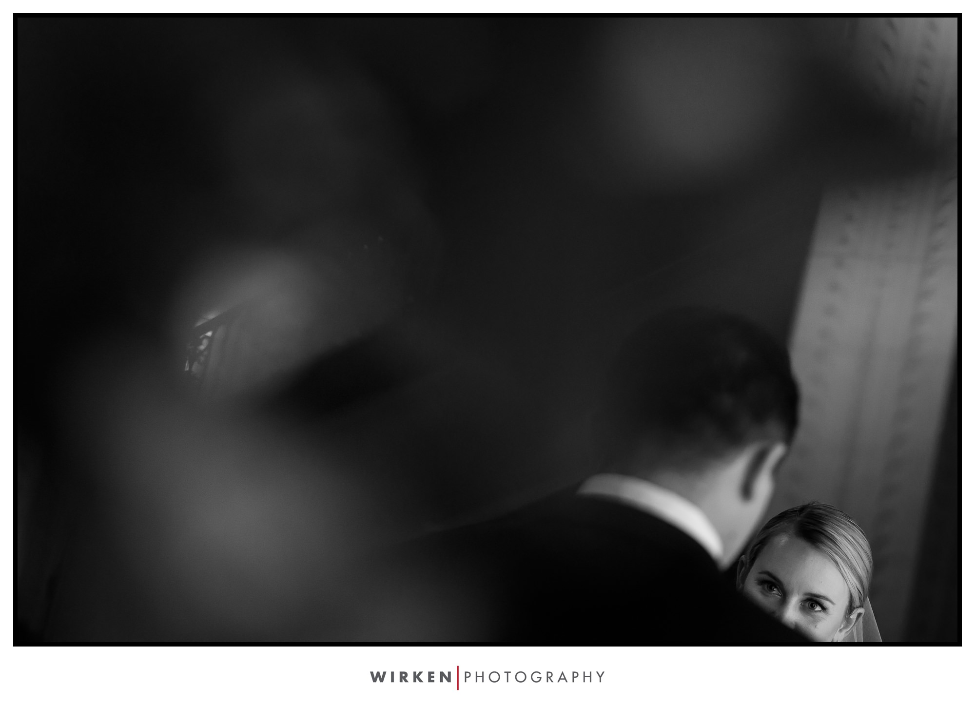 New Years Eve wedding ceremony in Kansas City. Bride gazes at groom.