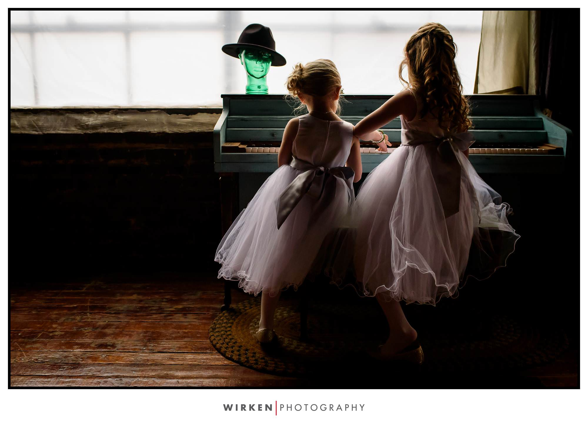 Flower girls play the piano at the West Bottoms Airbnb before Leah and Ryans wedding in Kansas City