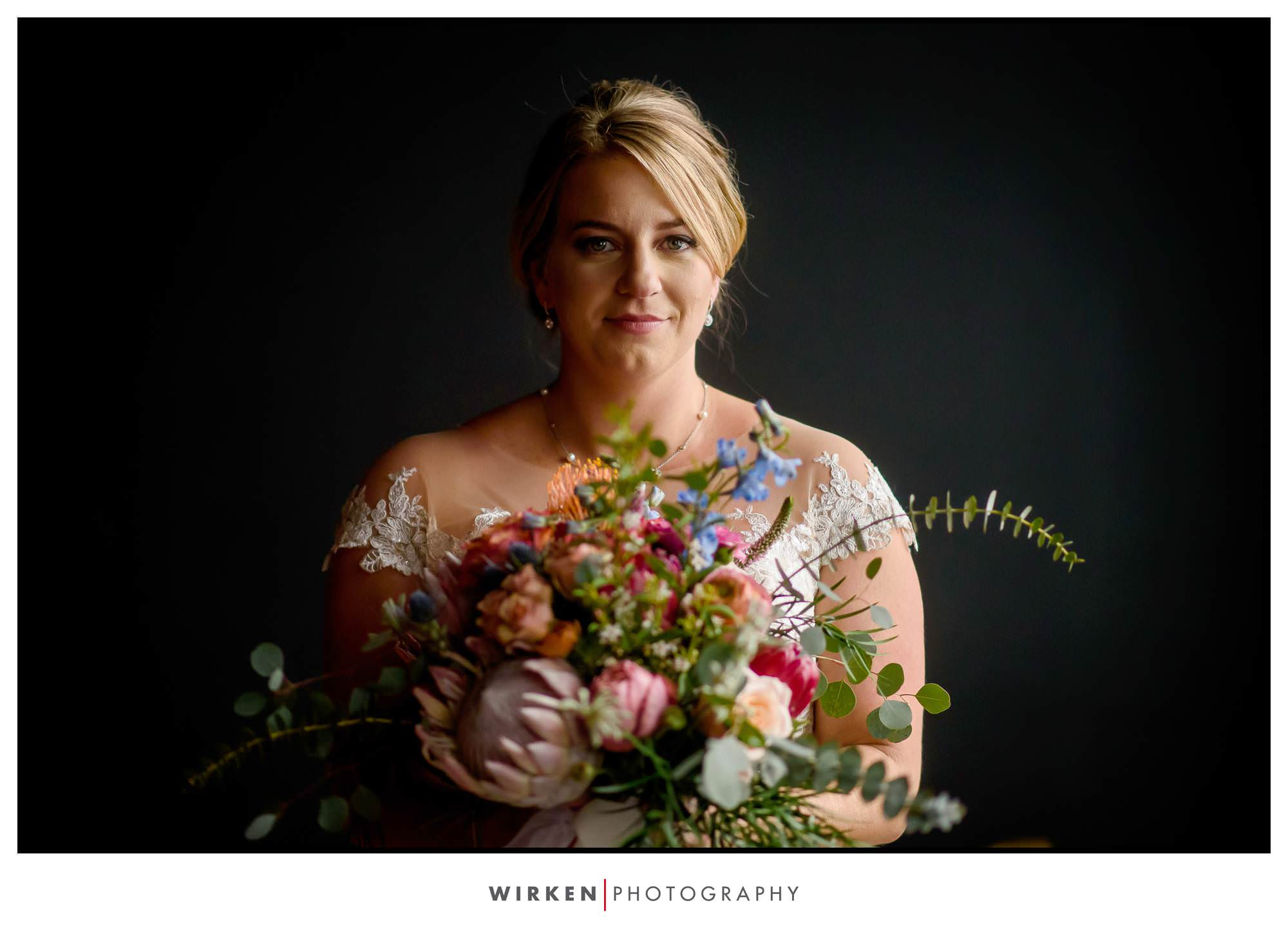 Leah and her beautiful wedding flowers before her Kansas City wedding