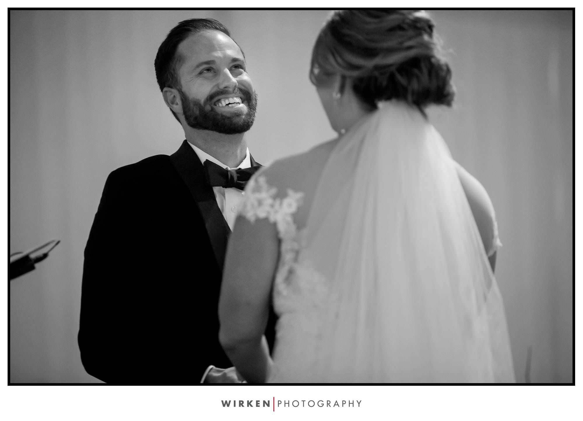 Ryan laughs during their wedding ceremony at the Gallery Event Center