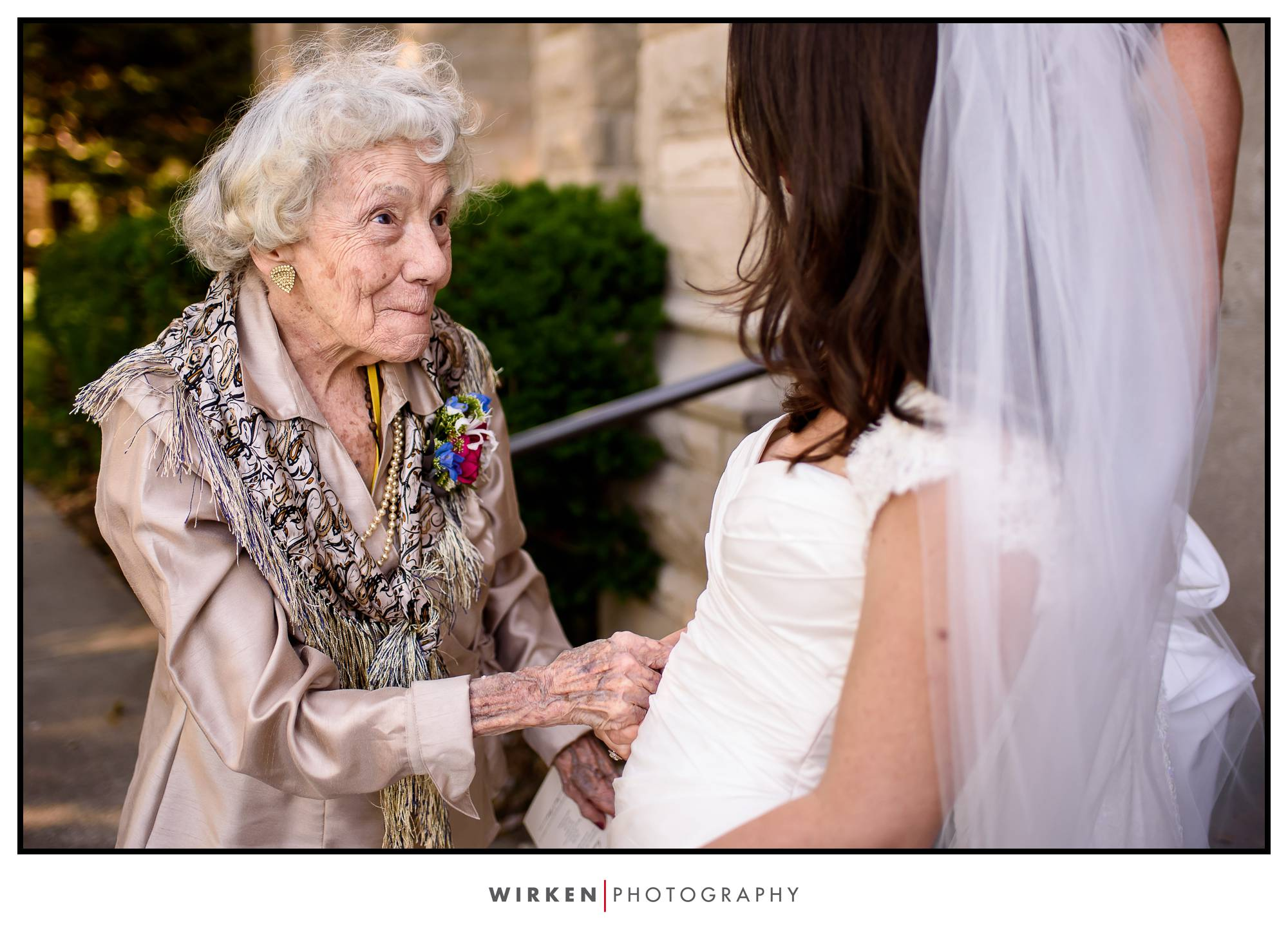 Grandma excited at her granddaughters wedding. Wedding photojournalism by documentary photographer, Tyler Wirken of Wirken Photo.