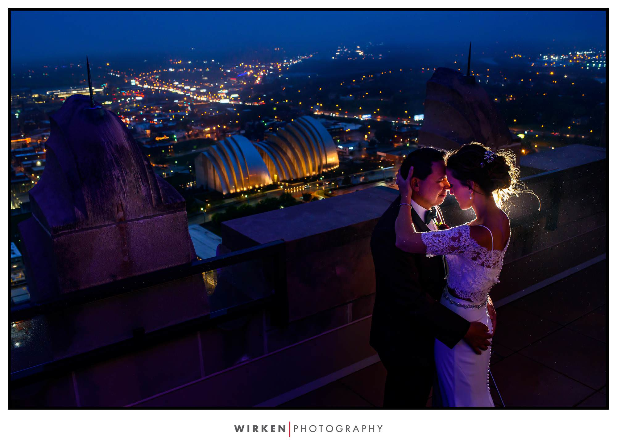 Bride and Groom on the rooftop of the Grand Hall in Kansas City with Kansas City Skyline.