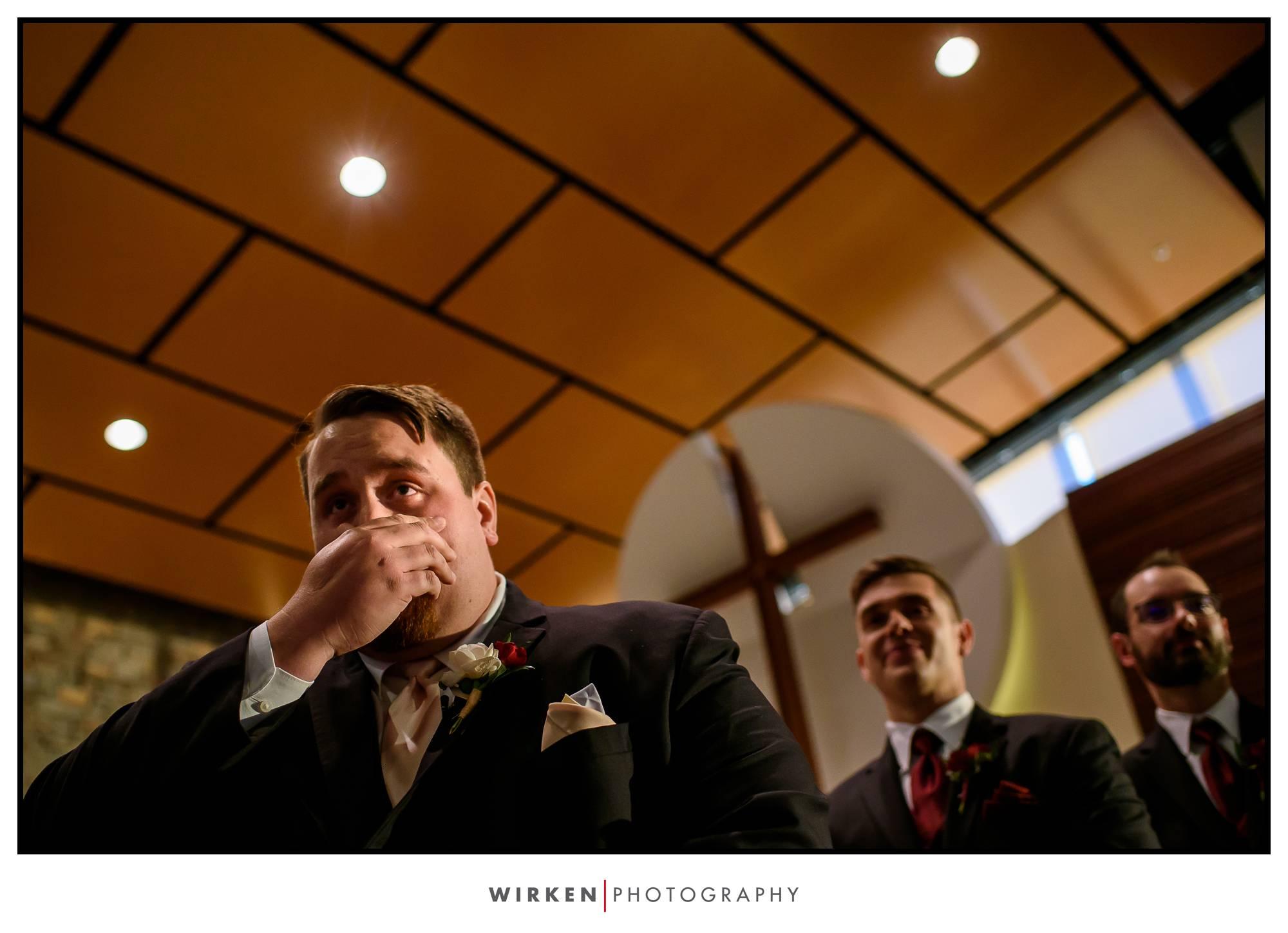 groom tearing up at kansas city wedding