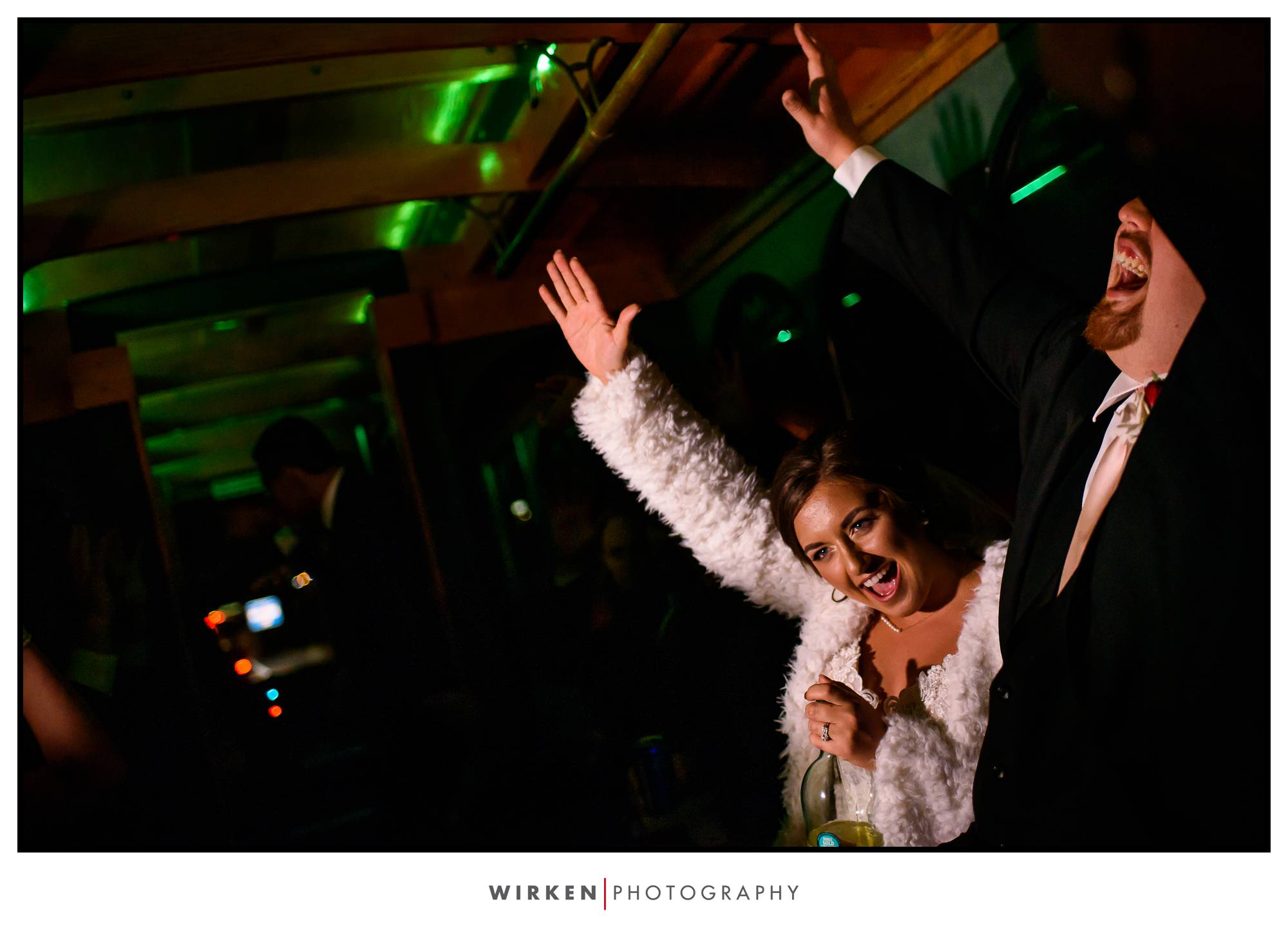 bride and groom on party bus for their kansas city wedding