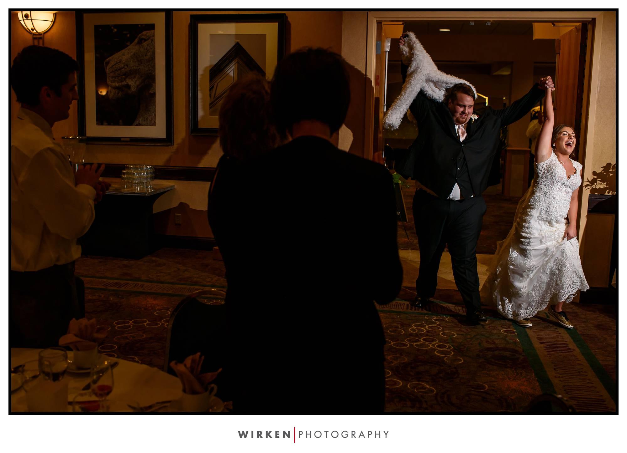 bride and groom enter their kansas city wedding reception