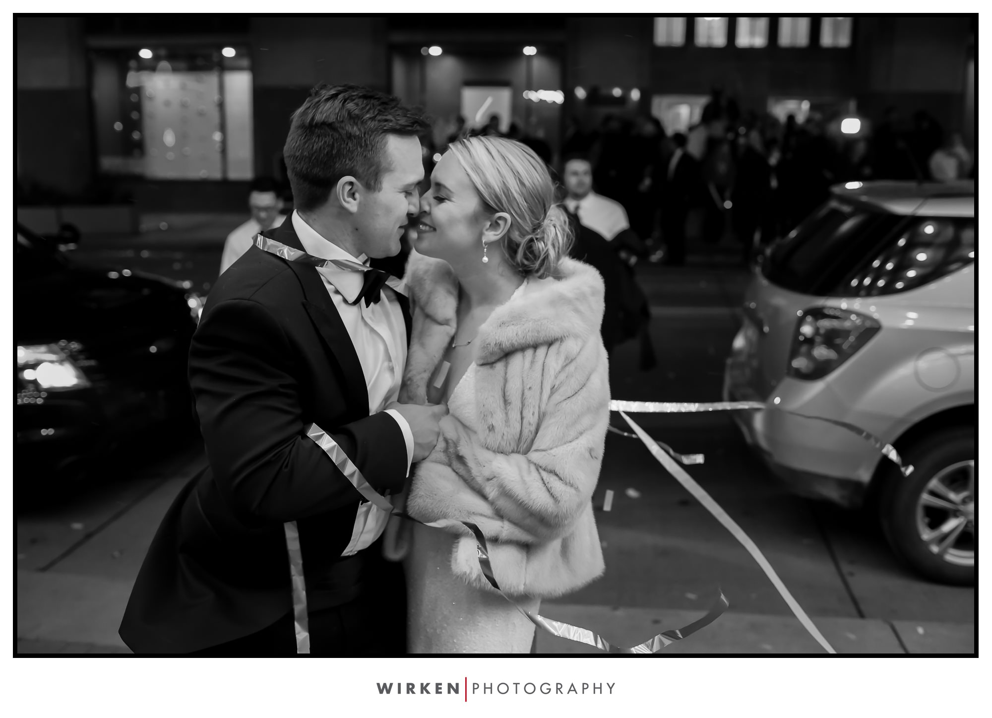Bride and Groom kiss as they enter their hotel after their New Years Eve wedding in Kansas City